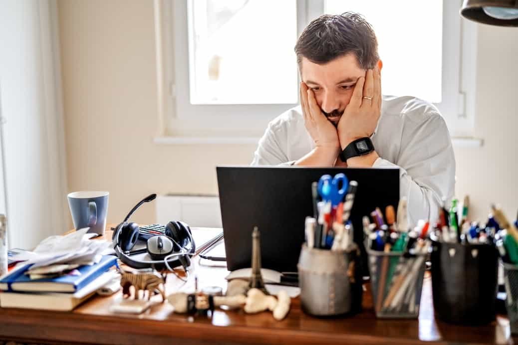 man frustrated with his IT systems while working from home