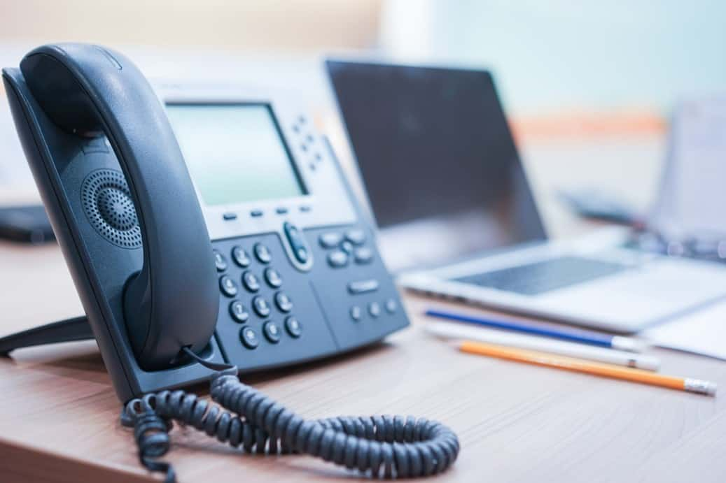 up close shot of a phone that utilizes VOIP services